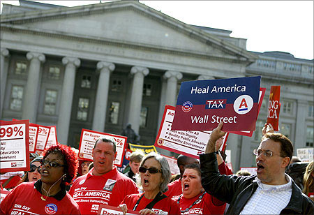 Protesters call on the Obama administration and the Treasury Department to tax Wall Street transactions in Washington.