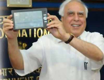 Union Minister of Communications & IT, Kapil Sibal with Aakash.