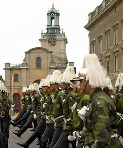 (Swedish armed forces soldiers in front of the Stockholm Cathedral in Gamla Stan, or the Old Town district of Stockholm