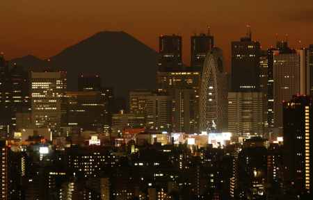 Japan's highest mountain, Mt. Fuji, is seen through skyscrapers in Tokyo.