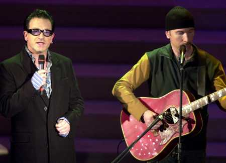 It also has a stake in music channel VH1. Rock group U2 performs on stage.