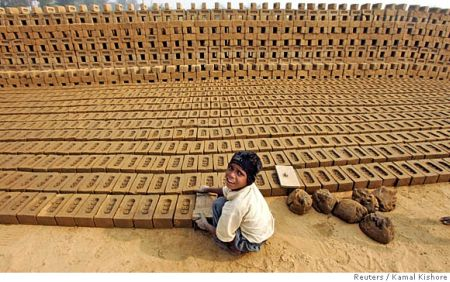 A boy works in a brick factory.