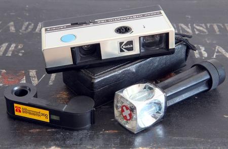 Kodak Instamatic 192 camera produced from 1975 to 1976, Kodak Magicube Extender and Kodacolor Gold 200 110 film cartridge.