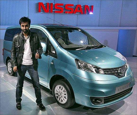Bollywood actor Ranbir Kapoor gestures during the unveiling of Nissan Motor Co's new Evalia car at India's Auto Expo in New Delhi on Thursday.