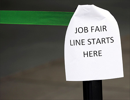 sign marks the entrance to a job fair in New York.