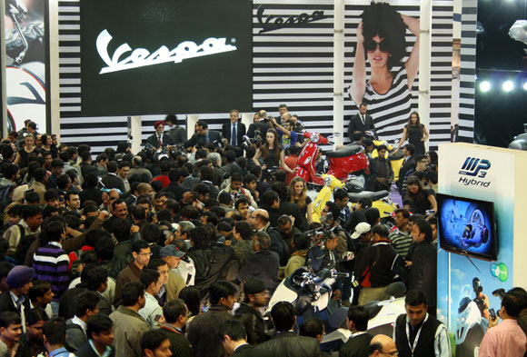 Crowds throng the Vespa launch.