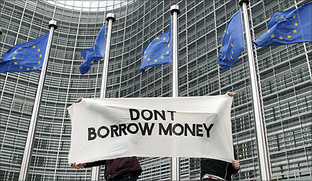 Students display a banner outside the EU Commission headquarters ahead of an European Union summit in Brussels.