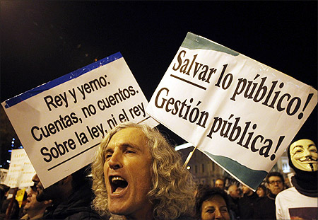 Protesters take part in a march called by the Spanish indignant movement against politicians, banks, the economic crisis and high unemployment in downtown Madrid.