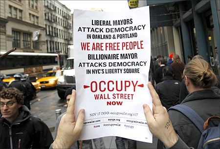 An Occupy Wall Street demonstrator holds up a sign during what protest organizers called a Day of Action in New York.