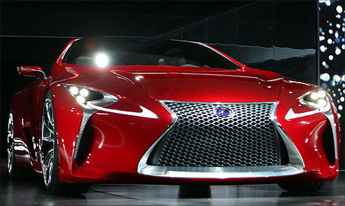 The Lexus LF-LC sports car concept is driven onto the stage.