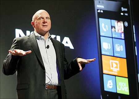 Microsoft CEO Steve Ballmer speaks about the Nokia Lumia 900 smartphone in Las Vegas.