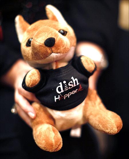 A woman holds a stuffed kangaroo.