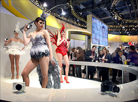 Models pose with Nikon digital cameras during the 2012 International Consumer Electronics Show (CES) in Las Vegas.