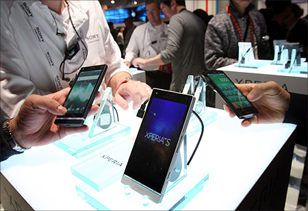 Showgoers look over Sony Experia.