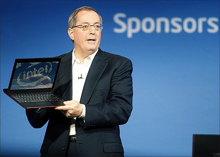 Paul Otellini, president and CEO of Intel Corporation, holds an ultrabook.