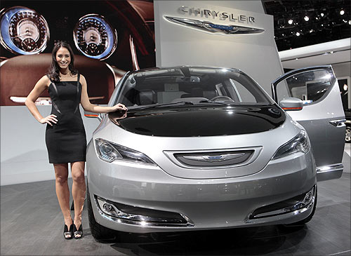 Model Tiffany Stone stands next to the Chrysler 700 C concept van.