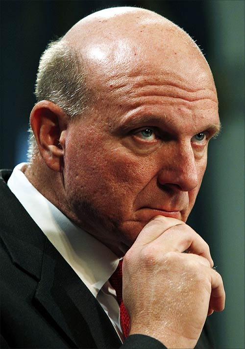 Microsoft Chief Executive Officer Steve Ballmer listens to a reporter's question at a news conference.