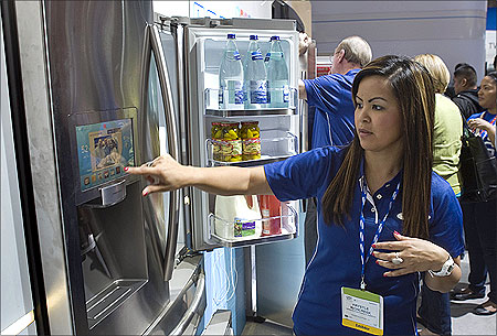 Samsung's Krystle Richcreek demonstrates a prototype Internet-enabled refrigerator.