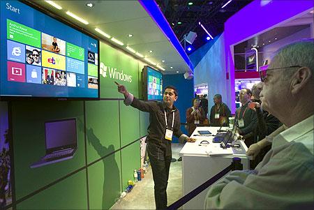 Visitors check a display at the Panasonic booth.
