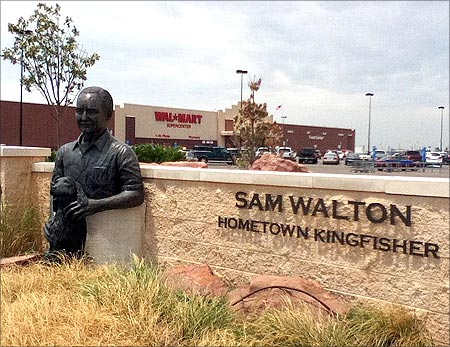 Statue of Sam Walton and his dog outside of Wal-mart in Kingfisher, Oklahoma.