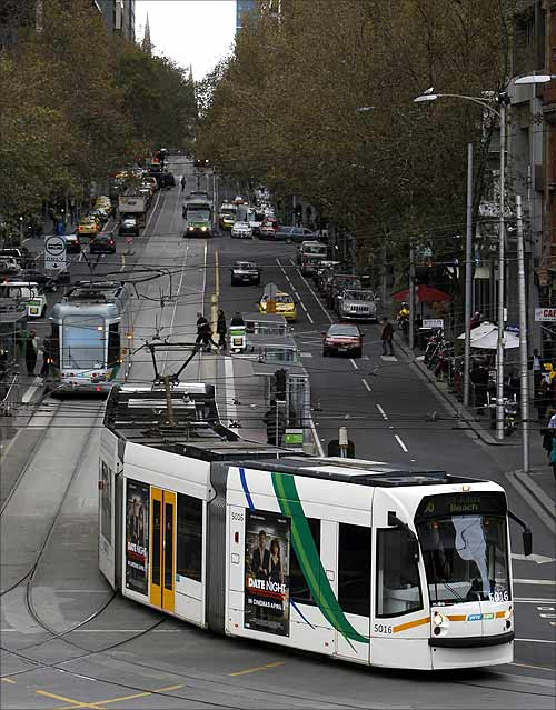 A tram travels on a road in central Melbourne.