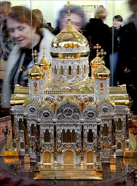 A visitor looks at a copy of Moscow's Christ the Saviour Cathedral made of gold, silver and precious stones at an exhibition in St Petersburg.