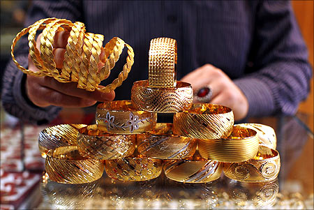 A goldsmith displays gold bangles in his jewellery shop in Istanbul.