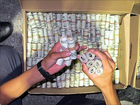 Dollars in cash are seen in this photograph released by Mexico's tax office in Mexico.