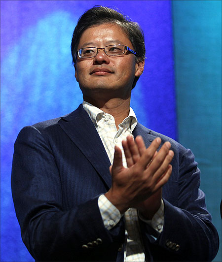 Jerry Yang applauds during the announcement of a commitment pledge at the Clinton Global Initiative in New York.