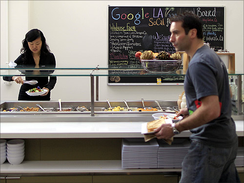 People eat in the cafeteria at the Google campus.