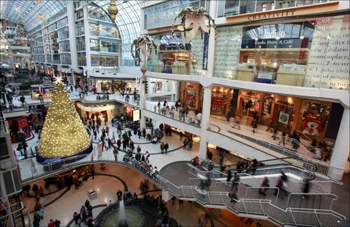 A Christmas tree is seen in the midst of shoppers in a major downtown shopping mall in Toronto.
