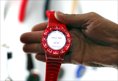 A watch phone by Burg is shown at the Cellular Telecommunications Industry Association event in San Diego.