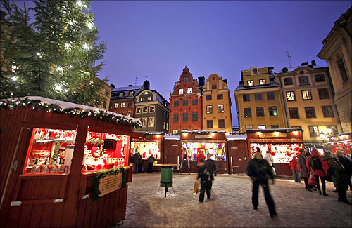 Visitors walk through the Christmas market in Stockholm's Gamla Stan district.