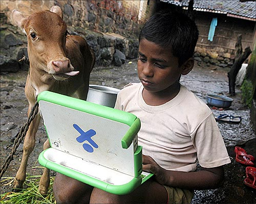 Harish, a school boy uses a laptop provided under the