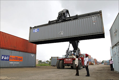 A mobile crane prepares to stack a container at Thar Dry Port in Sanand in the western Indian state of Gujarat.