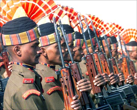New recruits of the Border Security Force attend their attestation parade at a camp in Humhama, on the outskirts of Srinagar.