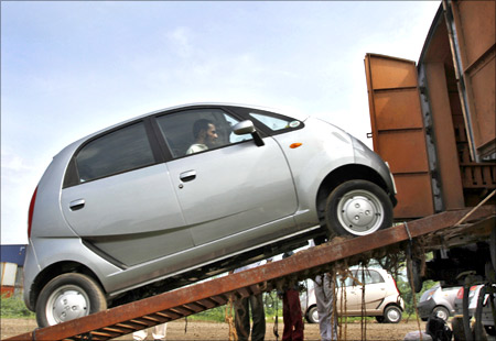 A Tata Motors Nano car is loaded onto a goods train for shipment at Sanand railway station.