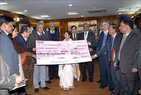 Former Railway Minister Mamata Banerjee received a dividend cheque for the year 2009-10 from the Indian Railway Finance Corporation Limited.