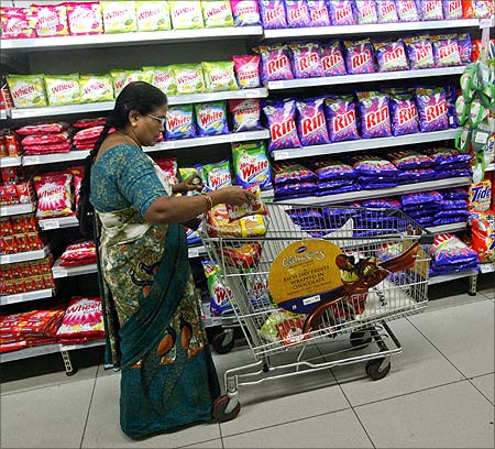 An Indian woman fills her trolley with retail products as she shops at a Hypercity department store.