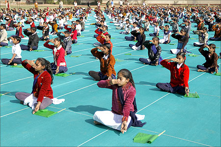 Schoolchildren attend a yoga session during a camp in Ahmedabad.