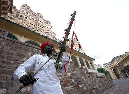 A Rajasthani artisan plays music at the entrance of the Meharangarh Fort in the historic town of Jodhpur.