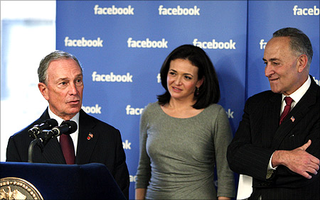 New York City Mayor Michael Bloomberg speaks to the media while Facebook's Chief Operating Officer (COO) Sheryl Sandberg and U.S. Senator Charles Schumer (L-R).