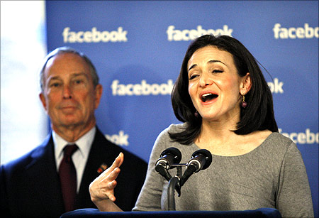 Facebook's Chief Operating Officer (COO) Sheryl Sandberg (R) speaks to the media next to New York City Mayor Michael Bloomberg.