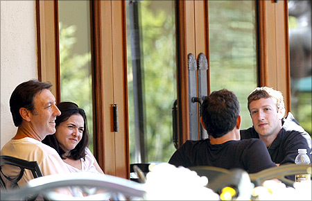 ESPN President George Bodenheimer, Sheryl Sandberg, Walt Disney Company CEO Robert Iger and Facebook CEO Mark Zuckerberg (L-R) talk at the Sun Valley Inn.
