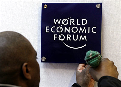 -A worker sets a logo of the World Economic Forum.