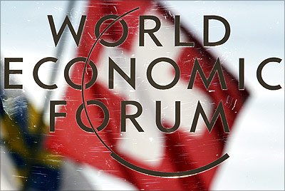 Switzerland's national flag is reflected in a sign for the World Economic Forum in Davos.