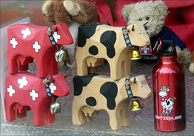 Souvenirs are seen in a shop window in Davos.