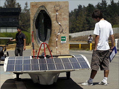 A man looks at a solar car during a promotional launch of the Atacama Solar Race 2012 in Santiago.