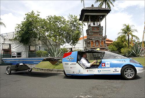 Louis Palmer drives his solar-powered car.