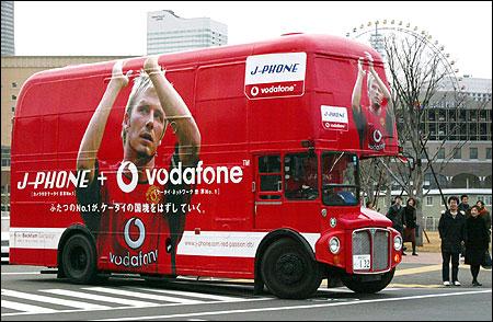 A double-decker bus with an advertisement featuring David Beckham runs in Yokohama,  on December 22, 2002.